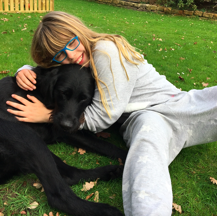 The youngest McKee volunteer internationally: Greta, who began at a very young age, visiting shelter dogs in South Africa. This is Greta with her dog Paul ...